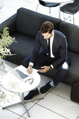 Businessman taking notes on table