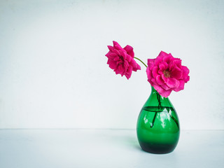 Beautiful pink flower in vase on table