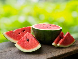 Fresh watermelon fruit on wooden table