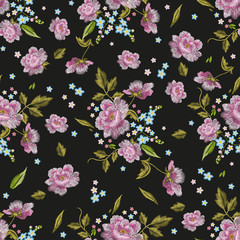 Embroidery colorful  seamless pattern with dog roses and forget me not flowers. Vector traditional folk fashion floral ornament on black background.