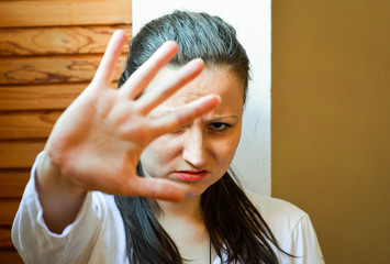 Scared Woman Showing Stop To Domestic Violence