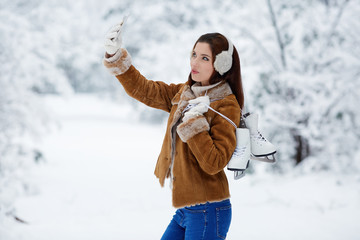 beautiful young woman with ice skates