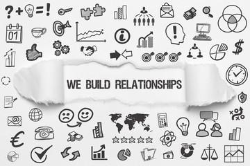 We Build Relationships / weißes Papier mit Symbole