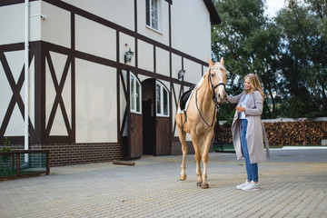 beautiful young girl and a horse, portrait, spring