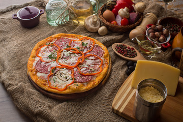Delicious italian pizza served on sackcloth