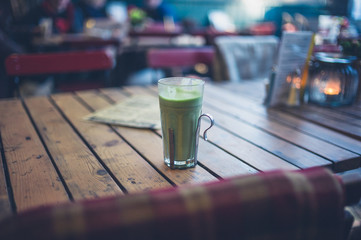 Green smoothie on table outside