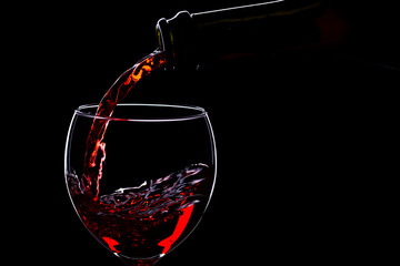 Wine glasses with wine bottle on a black background, minimalism,