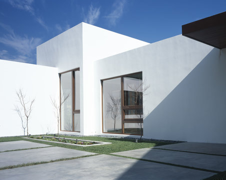 Modern white house and courtyard