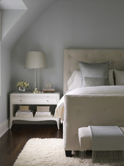 Double bed with white painted bedside table in contemporary transitional townhouse