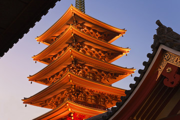 A telephoto view shows the Goju-no-to five-storied Pagoda at Senso-ji Temple in Asakusa and Tokyo Skytree (the world's tallest free-standing broadcast tower at 634 meters) with its adjacent 31-storied East Tower in the Sumida district, all located in the old downtown Shitamachi area of Tokyo, Japan.