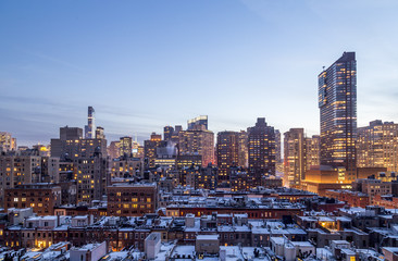 Snowy rooftops and mIdtown Manhattan at dusk, seen from 72nd street on the Upper West Side, New York.