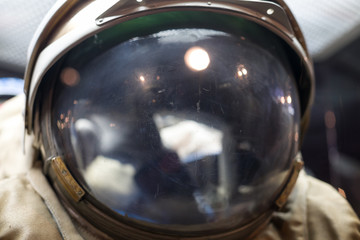 Closeup of astronaut helmet with reflections. Space and exploring.