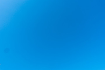 The cloudless blue sky background.