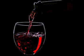 Wine glasses with wine bottle on a black background, minimalism,