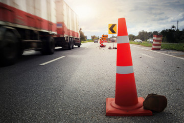 """Traffic cones and """" Diversion"""" sign outside a construction zone."""