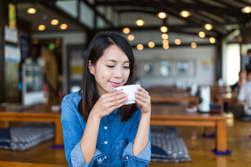 Woman drink of coffee in restaurant