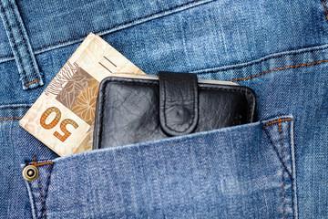 50 Reais on the jeans (Brazilian Money)