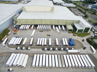 Aerial view factory HQ and commercial industry lorry semi-trucks