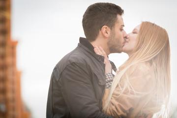 woman romantic love kiss man in urban city