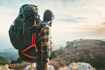 Man Traveler with big backpack hiking mountains expedition Travel Lifestyle success concept adventure active vacations outdoor mountaineering sport Wall mural