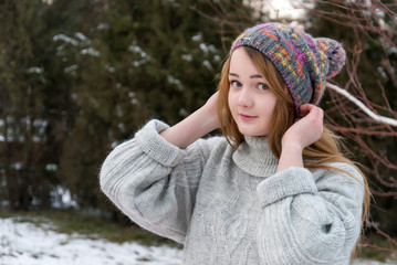 Funny Hipster Girl in Knitted Sweater and cap