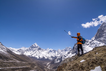 Everest Base Camp Trekking: Trekker enjoy the view of himalayas, Nepal.