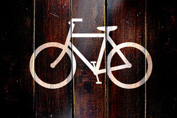 Vintage bike sign on a grunge wooden panel