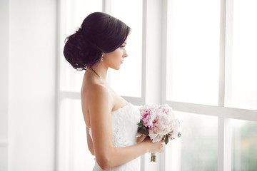 Stunning young bride holding bouquet