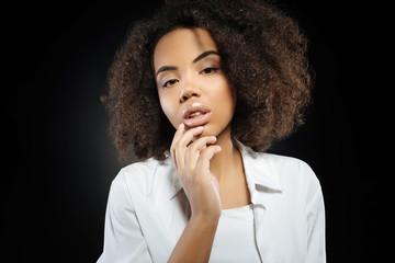 Sensual pretty woman wearing simple white shirt