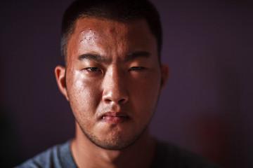 Portrait of Asia Man. Close up. Low key style.