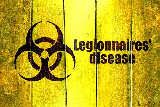 Vintage Legionnaires disease on a grunge wooden panel