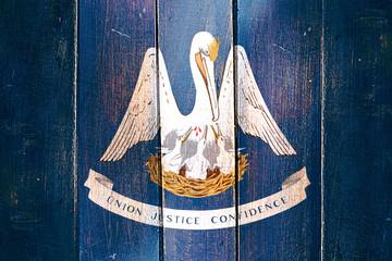 Vintage louisiana flag on grunge wooden panel