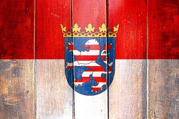 Vintage Hesse flag on grunge wooden panel