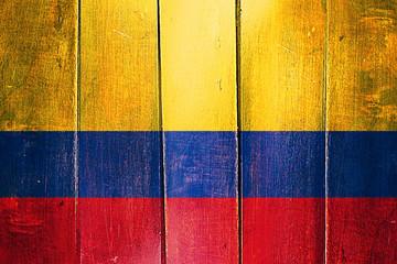 Vintage Colombia  flag on grunge wooden panel