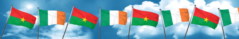 Burkina Faso flag with Ireland flag, 3D rendering