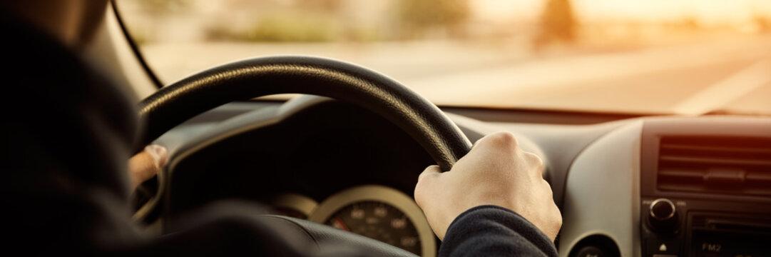 Driving car hands on steering wheel