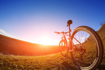 One cycle on a bright day with beautiful landscape background