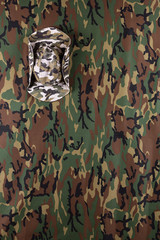 Military camouflage hat on background