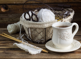 Wool yarn and knitting needles in a vintage basket