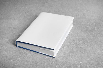 New book on gray background