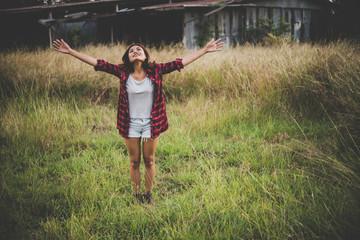 Young beautiful woman enjoying nature in field.