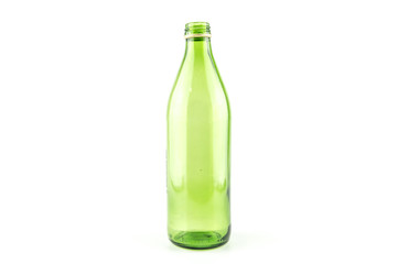 Glass green bottle of mineral water isolated on white background