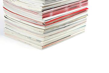 close up on stacking magazines isolated on white background