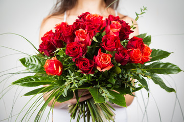 Woman Holding Bouquet Of Roses
