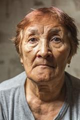 portrait of a pensive elderly woman