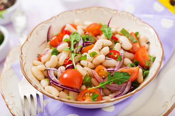 Salad of white beans, tomato, arugula, red onion  and pepper in bowl. Diet food. Healthy lifestyle. Sports nutrition.