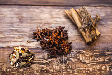 anise and cinnamon on the wood