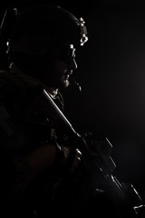 United states Marine Corps special operations command Marsoc raider. Contour backlit studio shot of Marine Special Operator black background