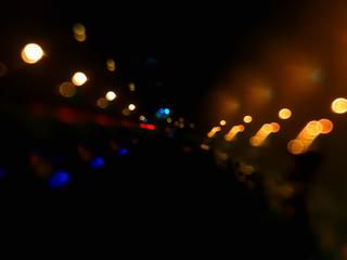 Night city lights on highway bokeh backdrop