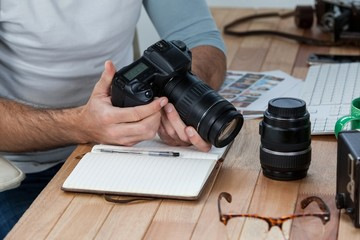 photographer reviewing photos in his camera